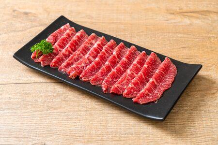 fresh beef raw sliced with marbled texture served for Sukiyaki and Shabu or Yakiniku Stok Fotoğraf
