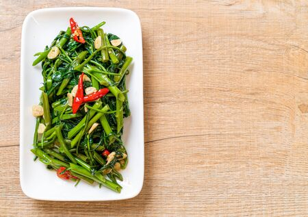 Stir-Fried Chinese Morning Glory or Water Spinach - Asian food style 스톡 콘텐츠