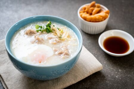 congee with minced pork in bowl - Asian breakfast style Stock Photo