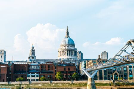 St Pauls Cathedral and the Millennium Bridge at sunset landscape in London, United Kingdom.