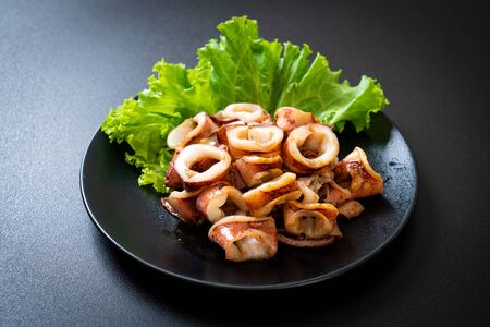 grilled squid on black plate