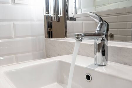 close-up tap or faucet in bathroom Stock Photo