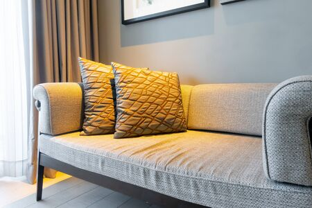 beautiful pillows decoration on sofa in living room interior