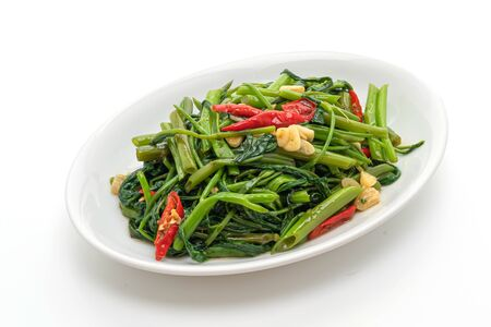 Stir-Fried Chinese Morning Glory or Water Spinach isolated on white background Stock fotó