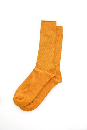 yellow mustard socks isolated on white background
