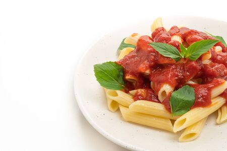 Penne pasta in tomato sauce isolated on white background