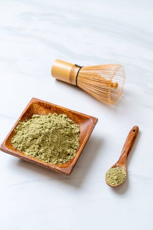matcha green tea powder with bamboo whisk