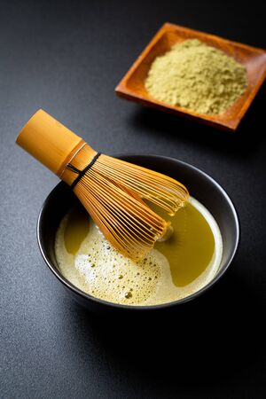 hot matcha green tea cup with green tea powder and bamboo whisk Reklamní fotografie - 137944331