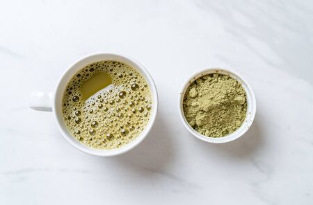 hot matcha green tea cup with green tea powder and bamboo whisk Reklamní fotografie - 138191463