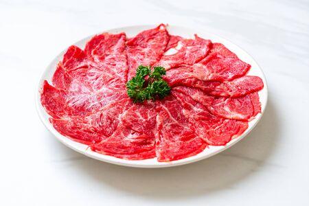 fresh beef raw sliced with marbled texture served for Sukiyaki and Shabu or Yakiniku Zdjęcie Seryjne
