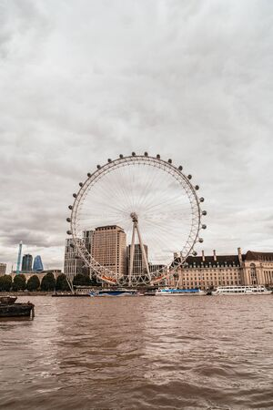 LondonUK - September 2, 2019: London Eye with Thames river in London, United Kingdom.