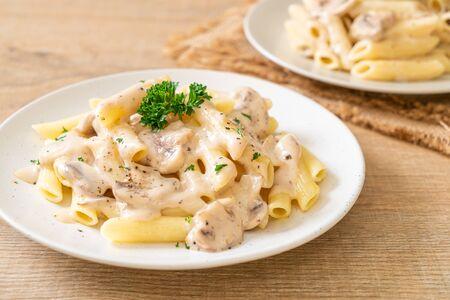 penne pasta carbonara cream sauce with mushroom - Italian food style
