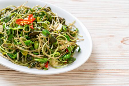 Fried Sunflower Sprout with Oyster Sauce - healthy food style 版權商用圖片