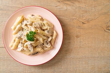 penne pasta alla carbonara salsa di crema di funghi - Italian food style