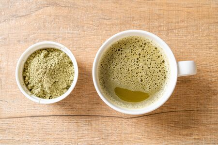 hot matcha green tea cup with green tea powder and bamboo whisk Reklamní fotografie