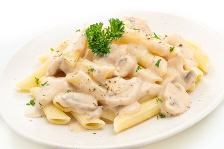 penne pasta carbonara cream sauce with mushroom isolated on white background