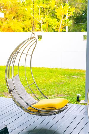 Pillow on swing chair decoration in garden