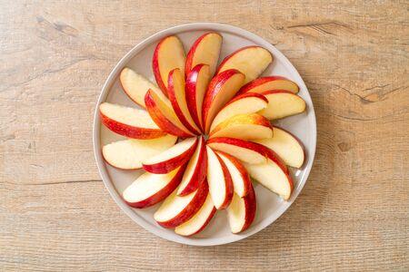 fresh red apple slice on plate Stock Photo