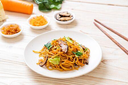 yakisoba noodles stir-fried with vegetable - vegan and vegetarian food