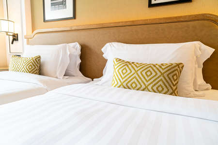 comfortable pillows decoration on bed in hotel bedroom