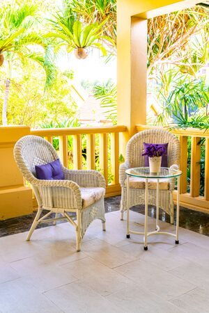 empty patio chair and table decoration on balcony