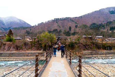 Shirakawa-go, Japan - Jan 12, 2020: Tourists visiting Shirakawa-go. Shirakawa-go is one of Japan's UNESCO World Heritage Sites located in Gifu Prefecture, Japan.