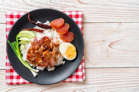 Barbecued red pork in sauce on topped rice - Asian food style