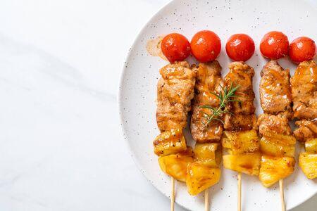 grilled pork barbecue skewer on plate
