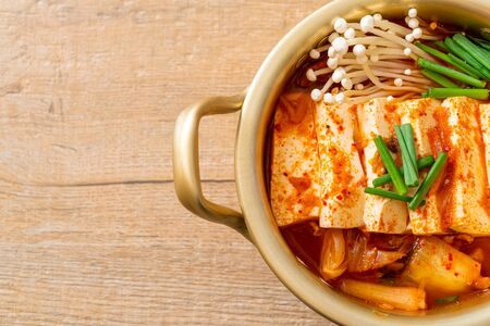 'Kimchi Jjigae' or Kimchi Soup with Soft Tofu or Korean Kimchi Stew - Korean Food Traditional Style