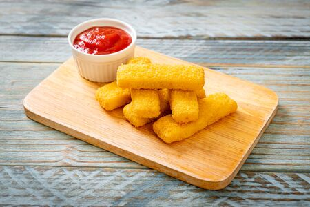 Crispy fried fish fingers with ketchup Stock Photo