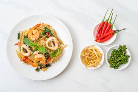 stir fried spicy noodles with sea food (Pad Cha Talay) - Thai food style