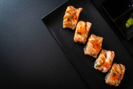 grilled salmon sushi roll with sauce - Japanese food style Stock fotó