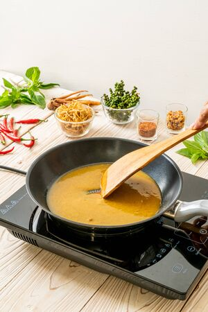 pouring water and sauce on pan ready to cooking