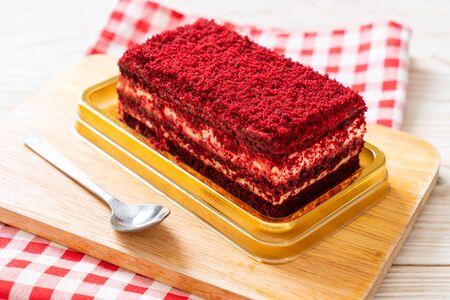 Delicious red velvet cake on table