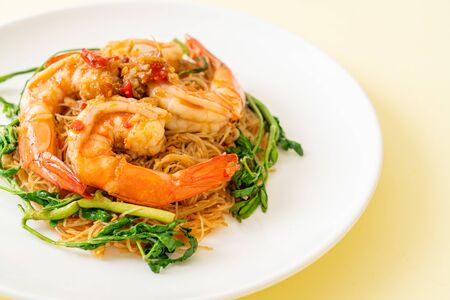 Stir-fried rice vermicelli and water mimosa with shrimps on plate