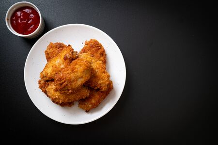 fried chicken wings with ketchup - unhealthy food
