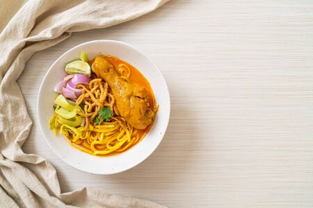 Northern Thai noodle curry soup with chicken (Kao Soi Kai) - Thai food style