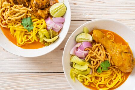 Northern Thai noodle curry soup with chicken and braised pork - Thai food style