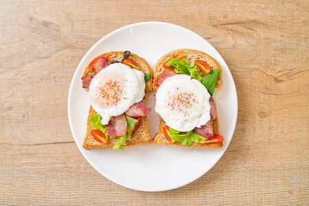 whole wheat bread toasted with vegetable, bacon and egg or egg benedict for breakfast Stock Photo