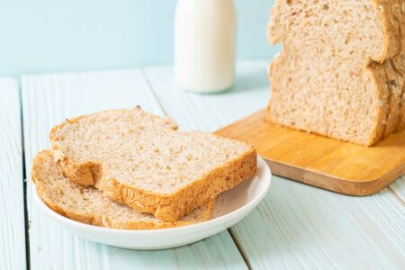 sliced wholegrain bread on a wooden table