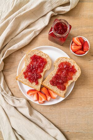 homemade whole wheat bread with strawberry jam and fresh strawberry