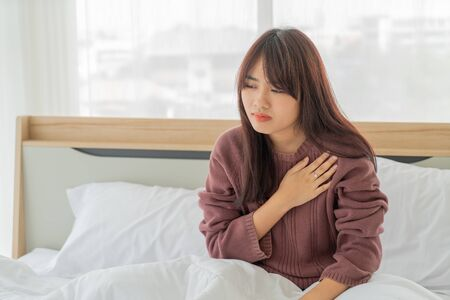 beautiful Asian women Heart disease on bed