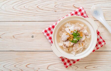 porridge or boiled rice soup with fish bowl