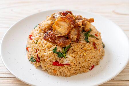 fried rice with Thai basil and crispy belly pork - Thai food style Reklamní fotografie