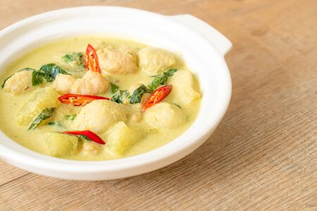 green curry soup with minced pork and meat ball in bowl - Asian food style