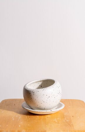empty and beautiful clay flower pot on wood table