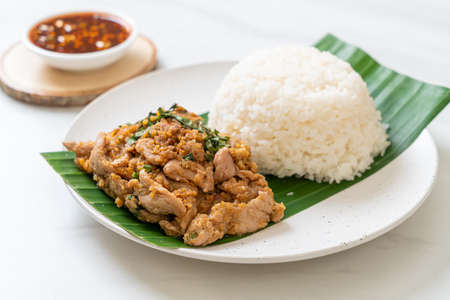 rice with grilled spicy pork and herb - Asian food style