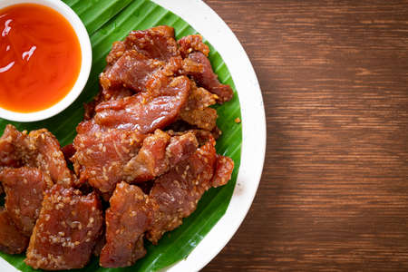 sun dried pork with sauce on plate