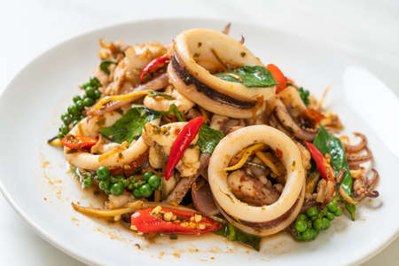 stir fried holy basil with octopus or squid and herb - Asian food style