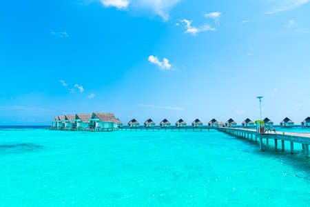 Beautiful tropical Maldives resort hotel and island with beach and sea  - boost up color processing style Publikacyjne